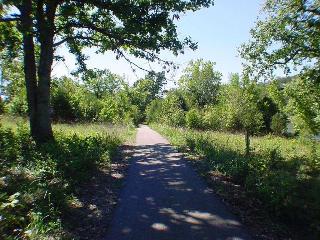 Paved walking trail at the edge of the property.
