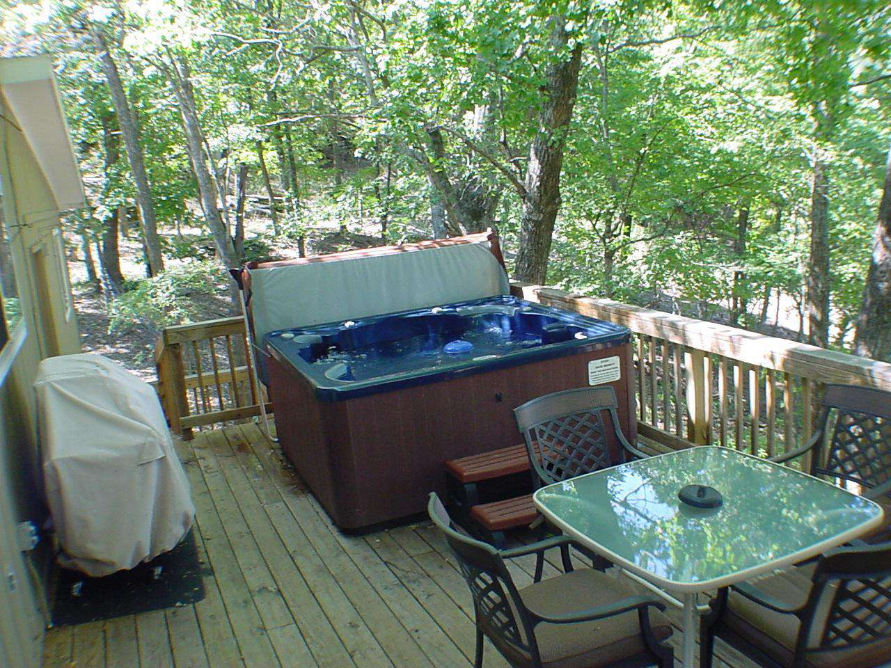 Large deck with private six-person hot tub