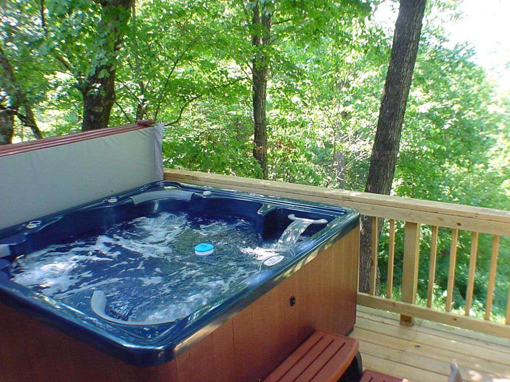 Private six-person hot tub on a deck in the tree tops.