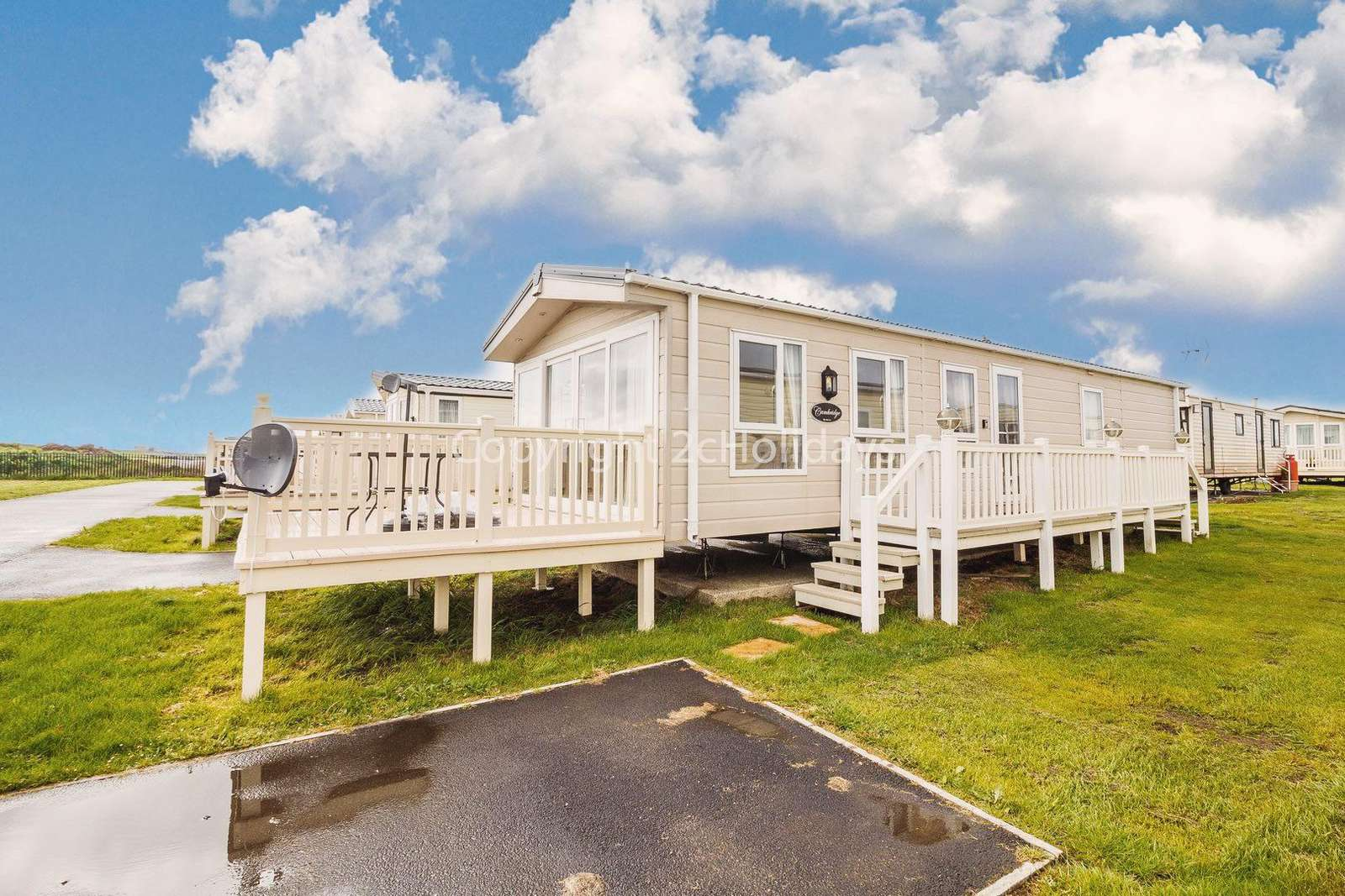 6 berth caravan with decking at St Osyth Beach Holiday Park. - property