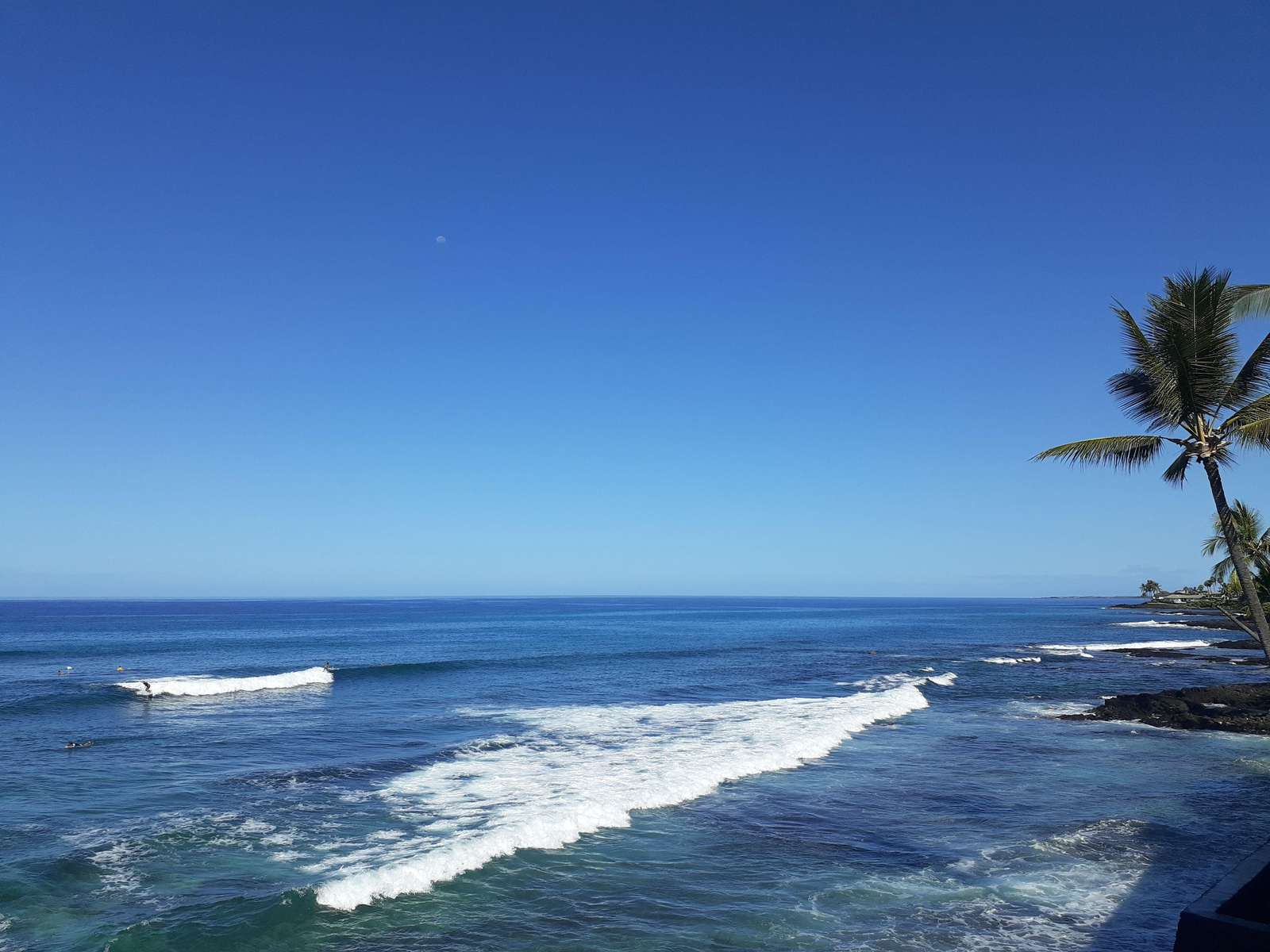 Sparkling day views. Watch the surfers and, you may see a whale in winter!