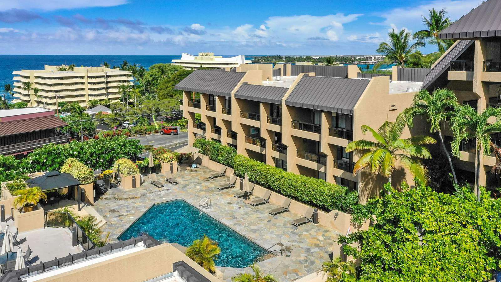 Kona Pacific is a great resort right in town.  Walk to shops, restaurants & more.