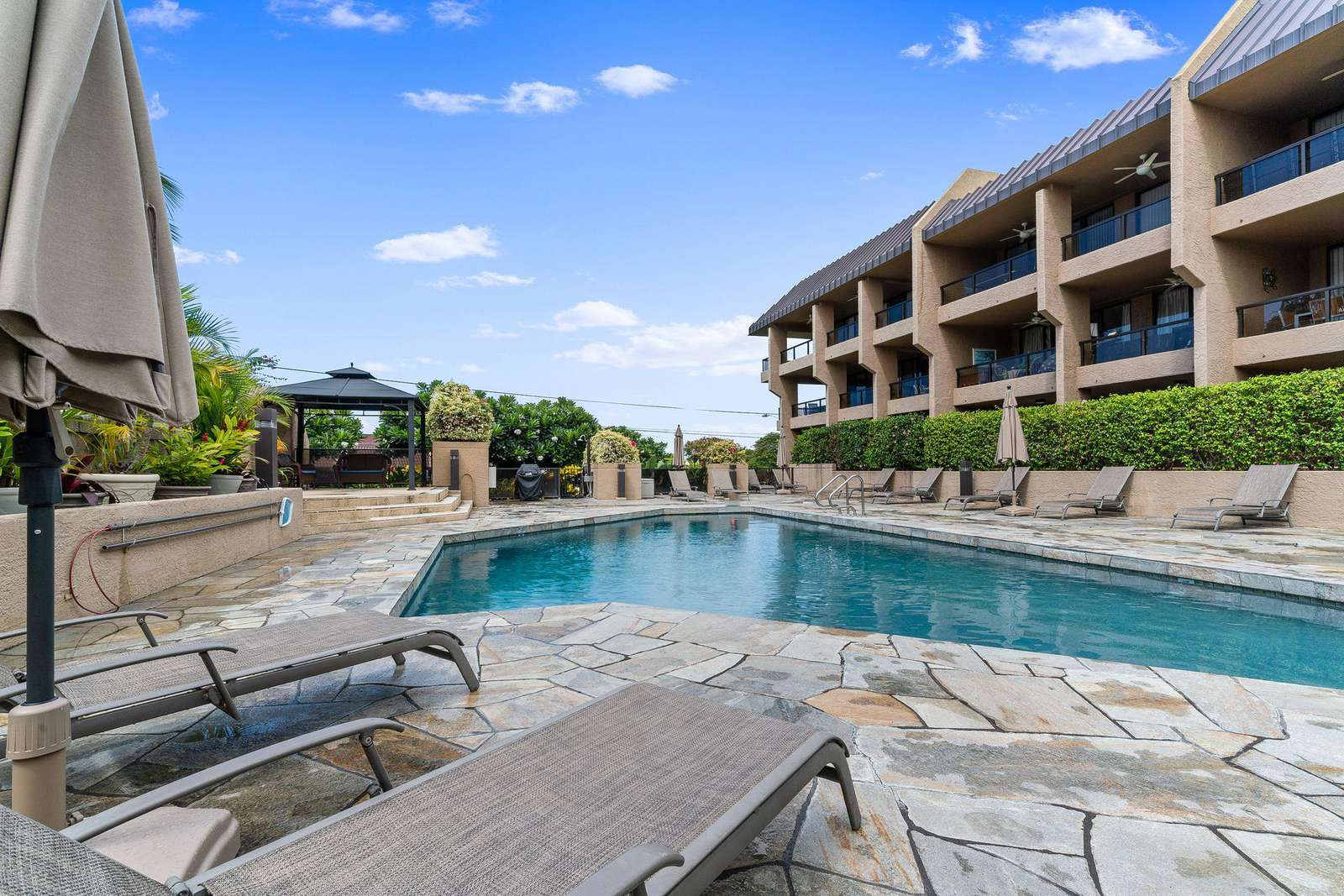 Beautiful elevated pool and sundeck area.