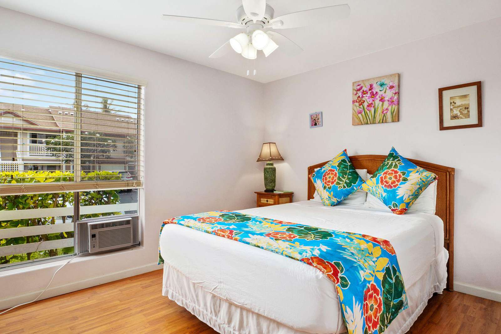 Guest room with AC and queen bed.
