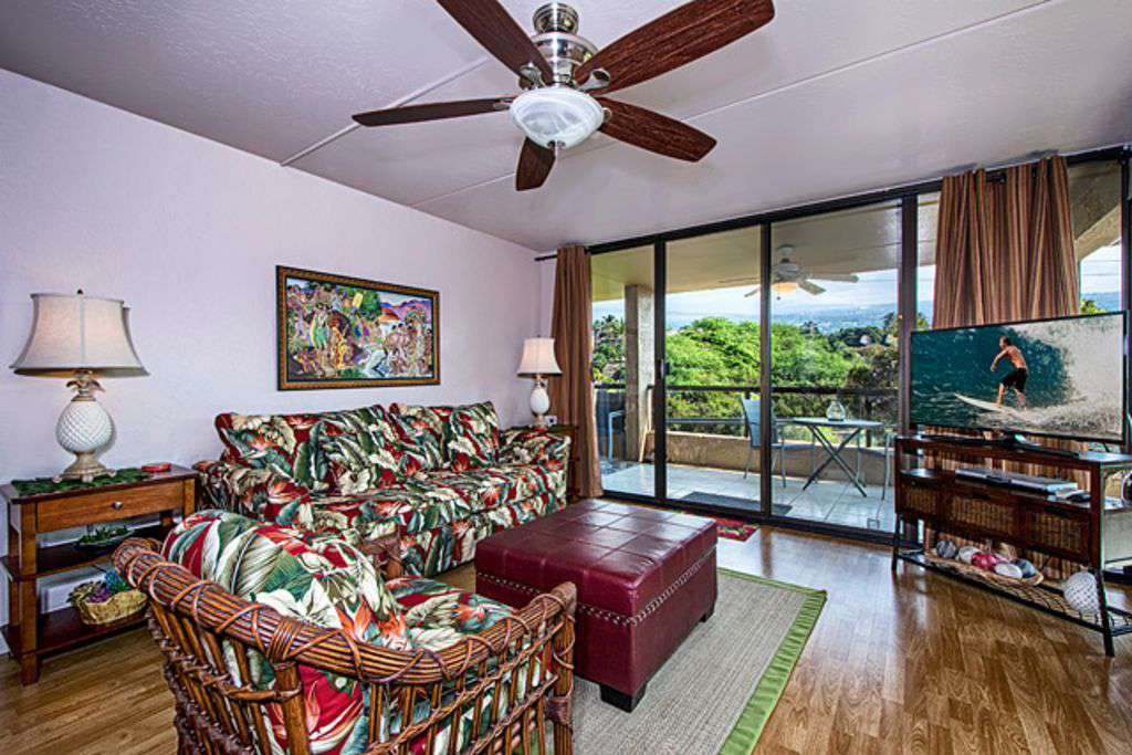 Living area with all new furnishings and entry to wraparound lanai.