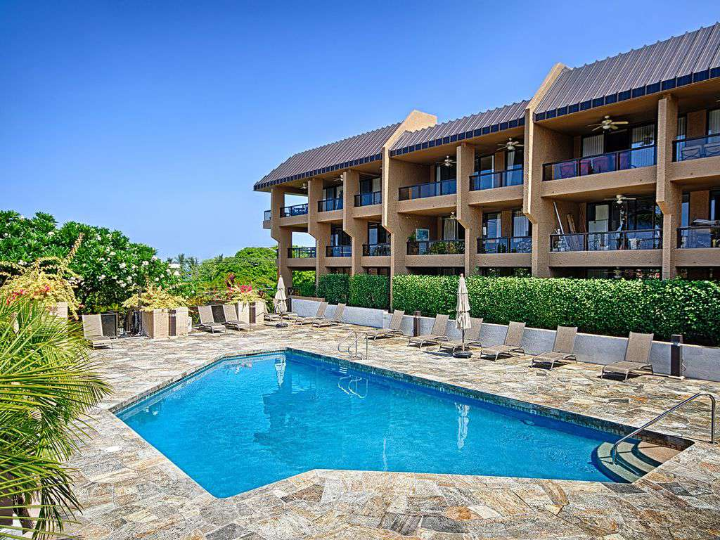 Beautiful pool with sundeck that has an ocean view.  BBQ grills here.