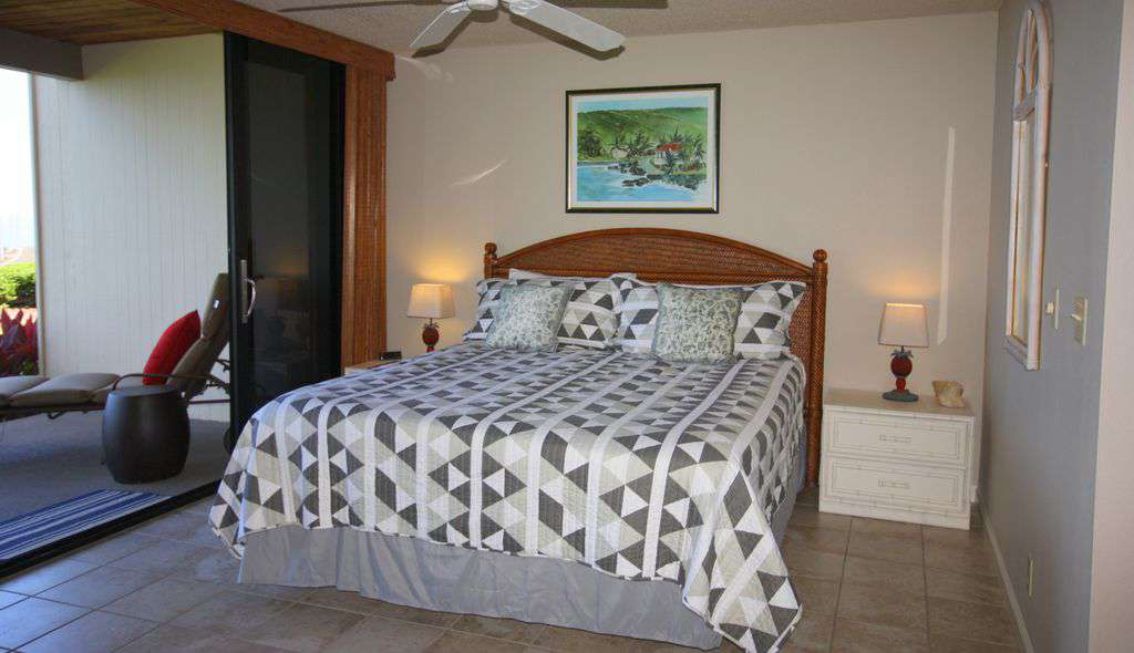 Master bedroom, king bed and sliders to the lanai, with ocean views.