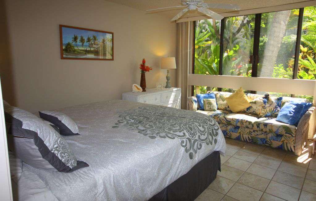 Guest bedroom has huge slider windows to let in the breeze.