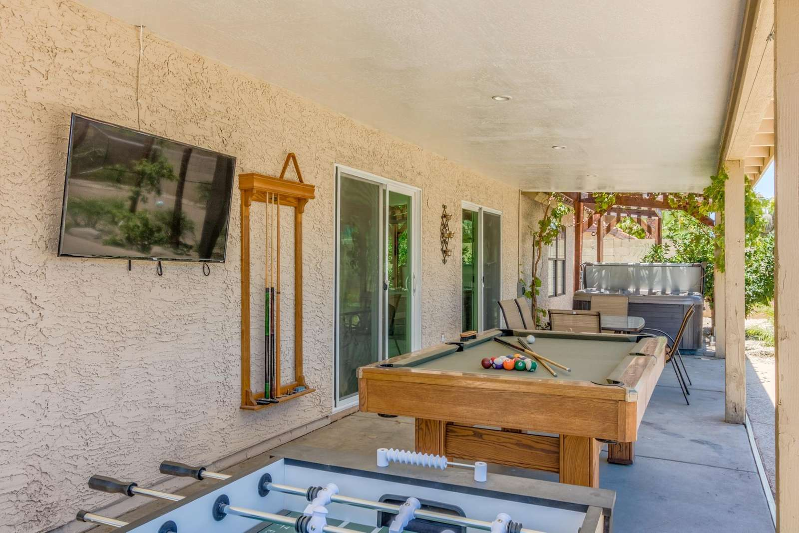 Outdoor TV / Pool Table / Foosball & Dining Table.