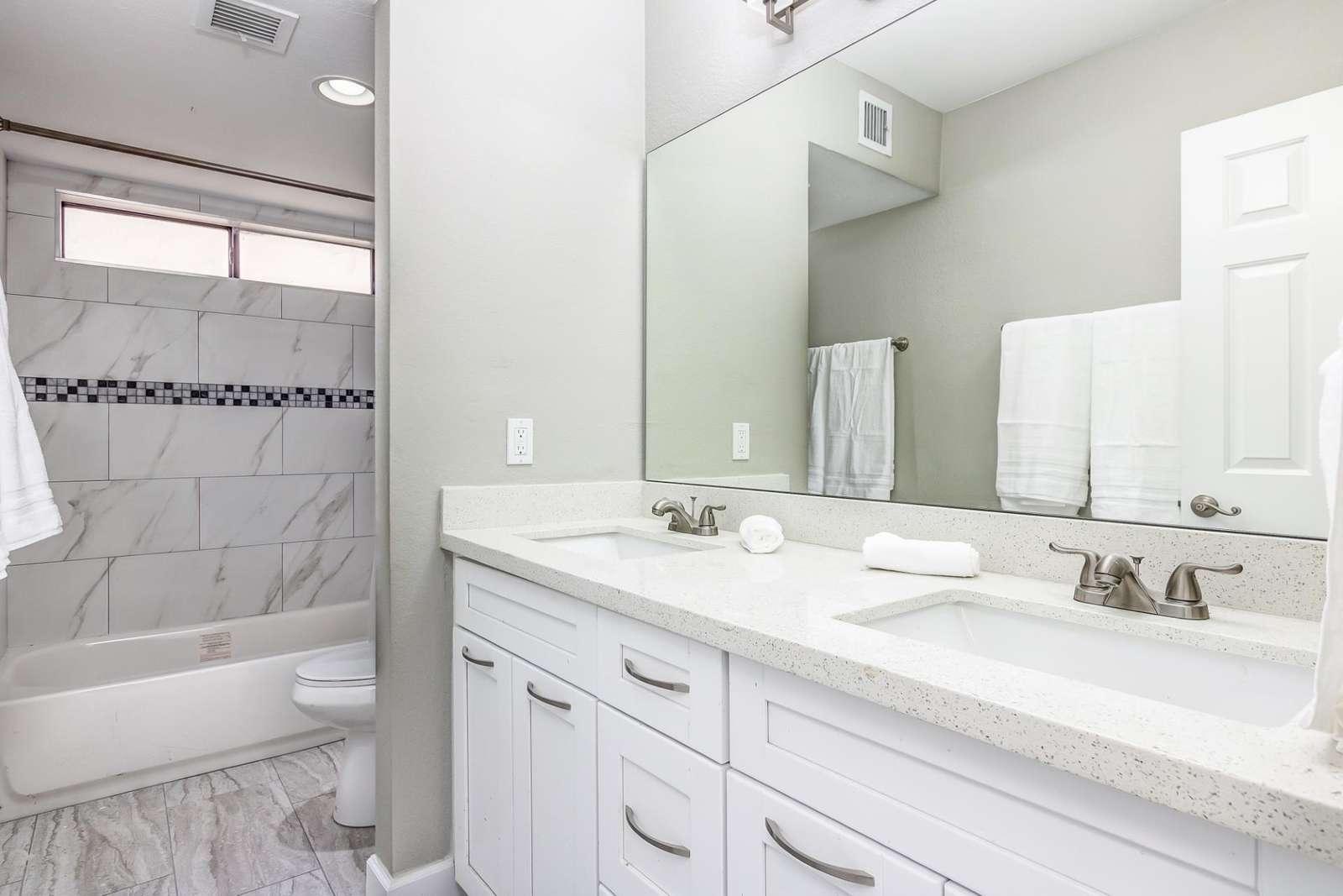 Main Bathroom has a Double Vanity - Shower / Tub Combo