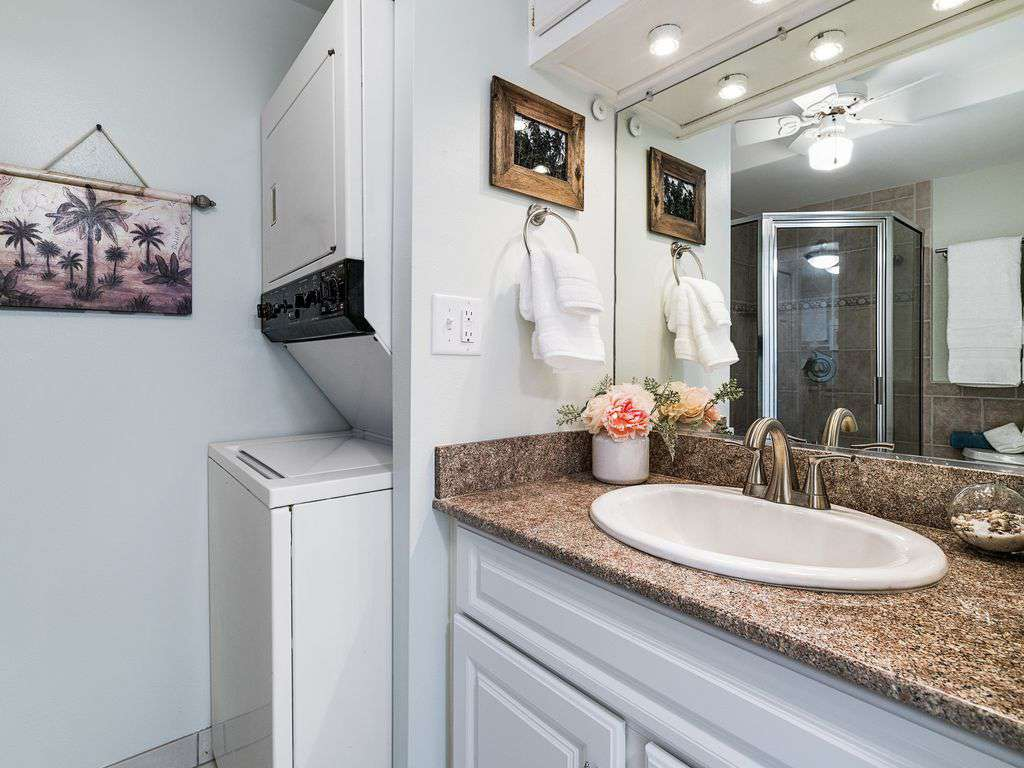 GUEST BATH HAS FULL SIZE WASHER/DRYER.