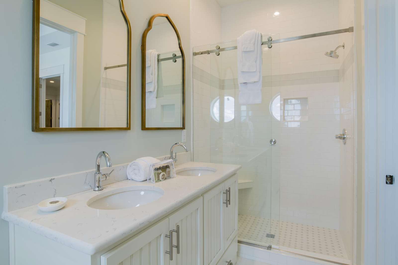 Custom tiled shower walls w/ glass sliders in every bathroom. 8 walk-in  showers &  4 tub-shower combos.