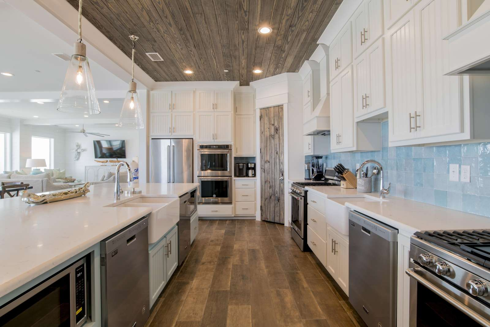 Kitchen with 3 dishwashers, 3 full size refrigerators, 2 gas range cook tops and and 4 ovens.