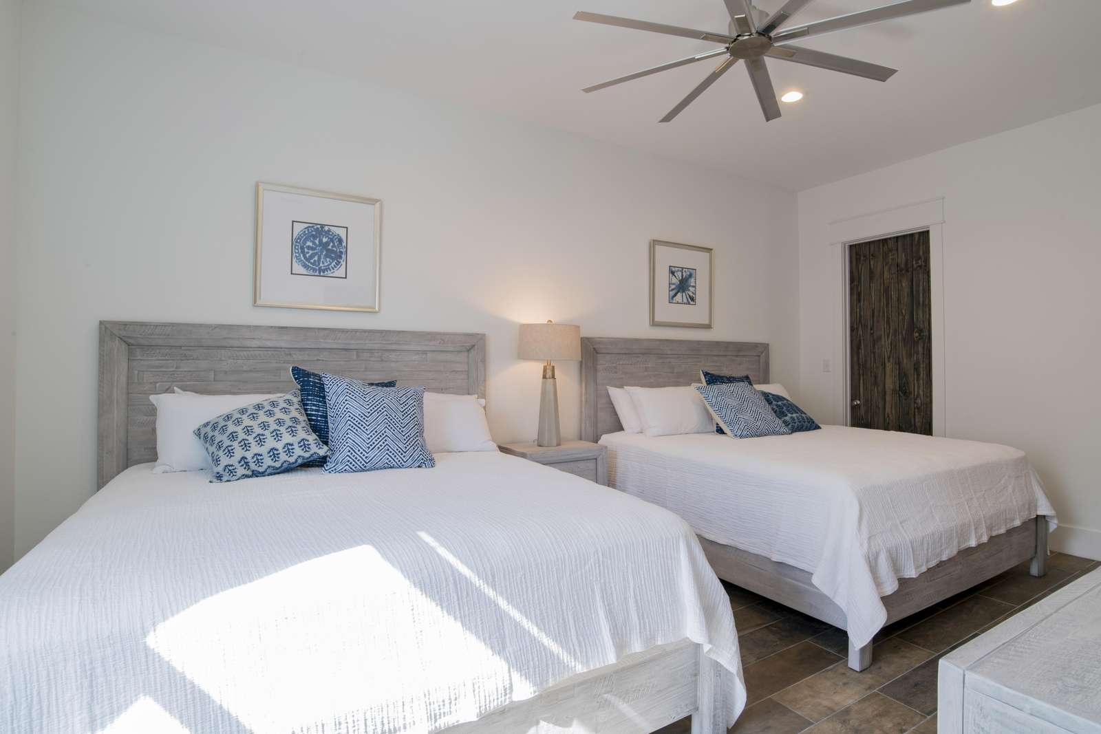 1st Floor North West bedroom. 2 full size king beds with private bath. Sleeps 4.