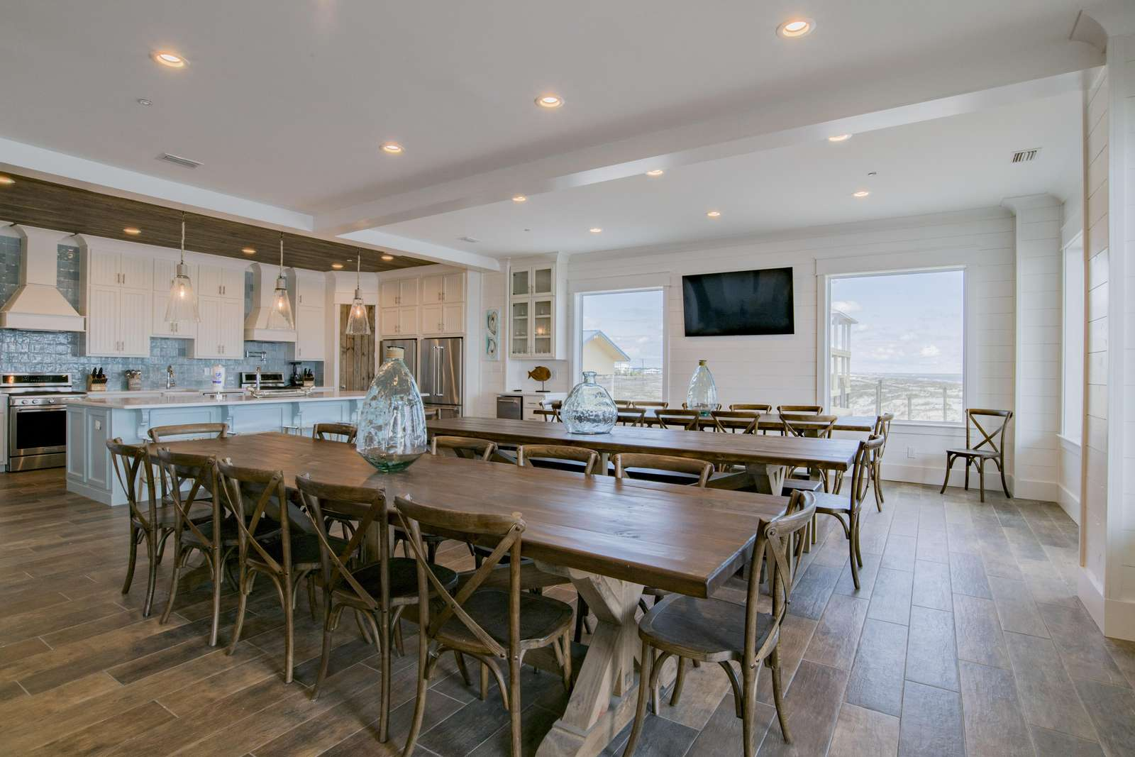 Dining Room with 3, 12 ft dining tables and 65 inch flatscreen.