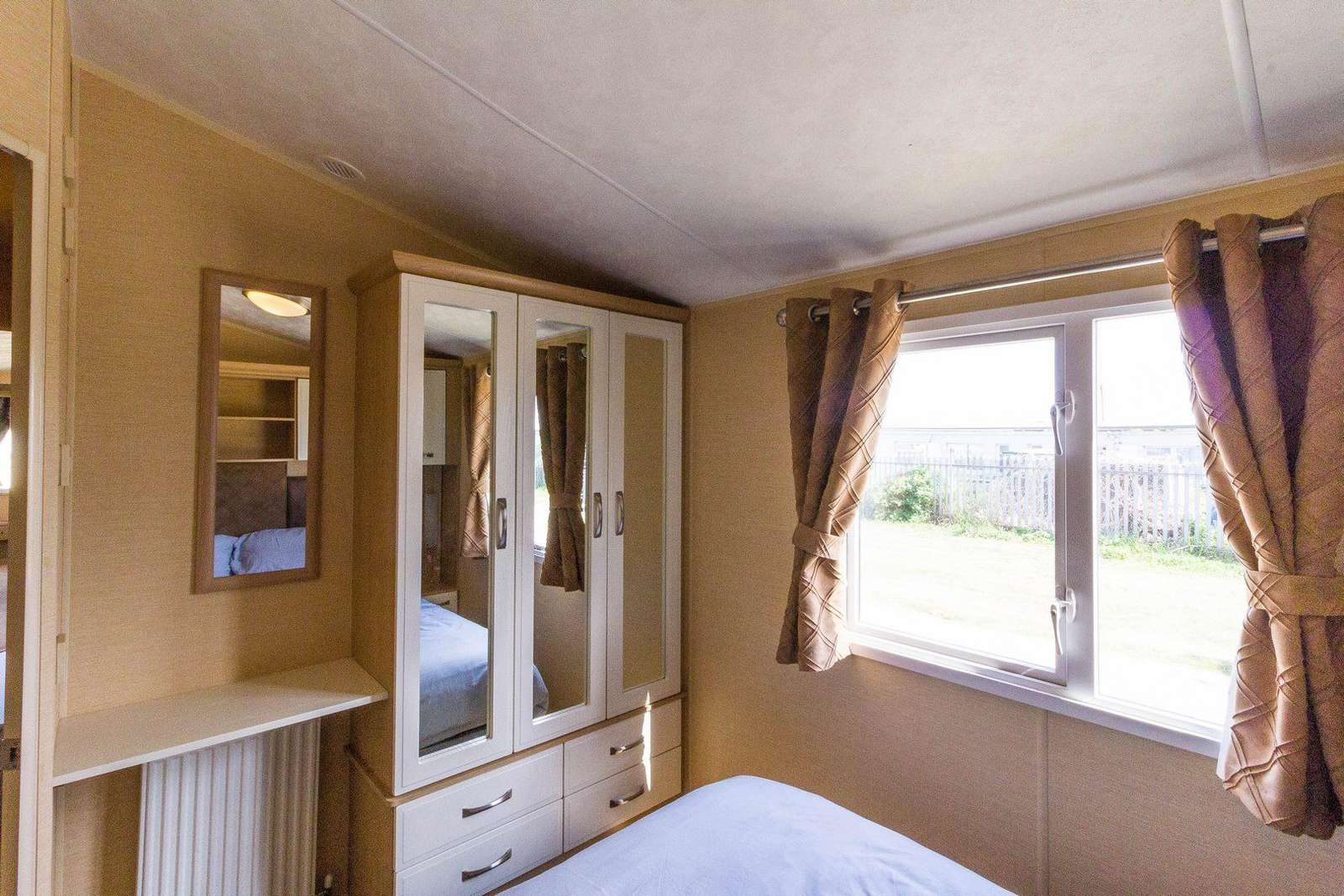 You can find plenty of storage in this master bedroom