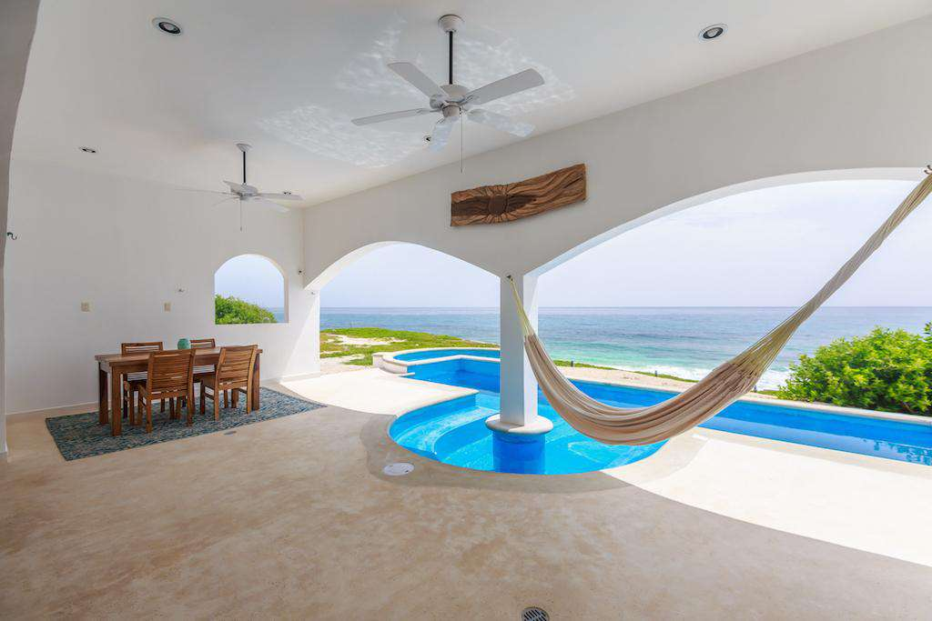 Relax under the shade in a hammock next to the pool with sounds of the Caribbean waves