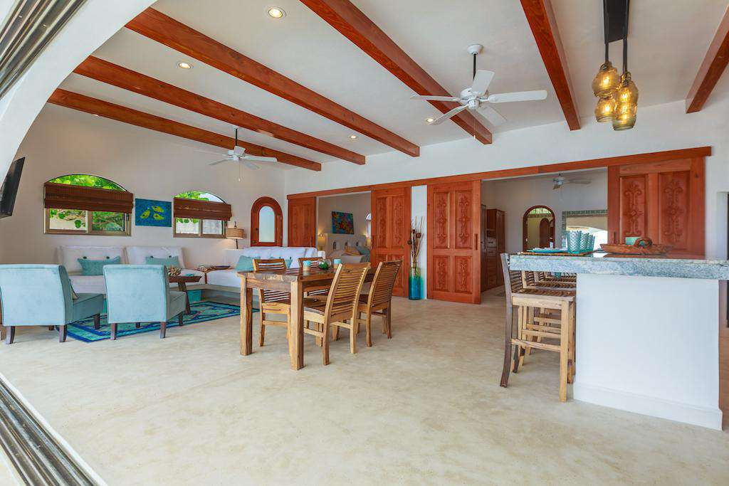Large wooden doors open at the back of the living area to to the 2 Master Suites.