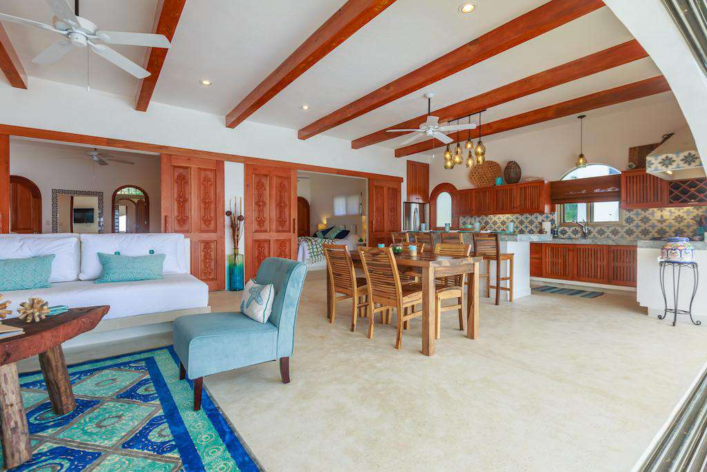 Spacious living area with lounge, dining and kitchen