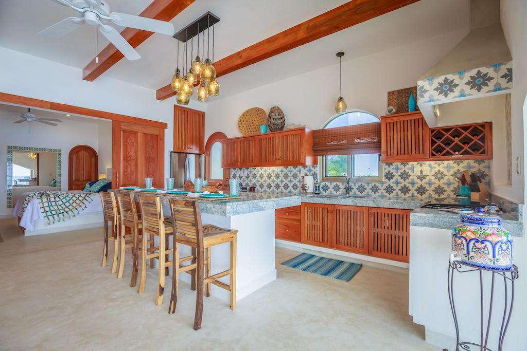 Master Suite in through large wooden doors behind kitchen