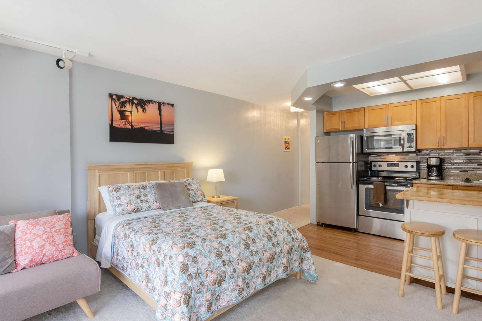 View of Full Size Bed & Kitchen