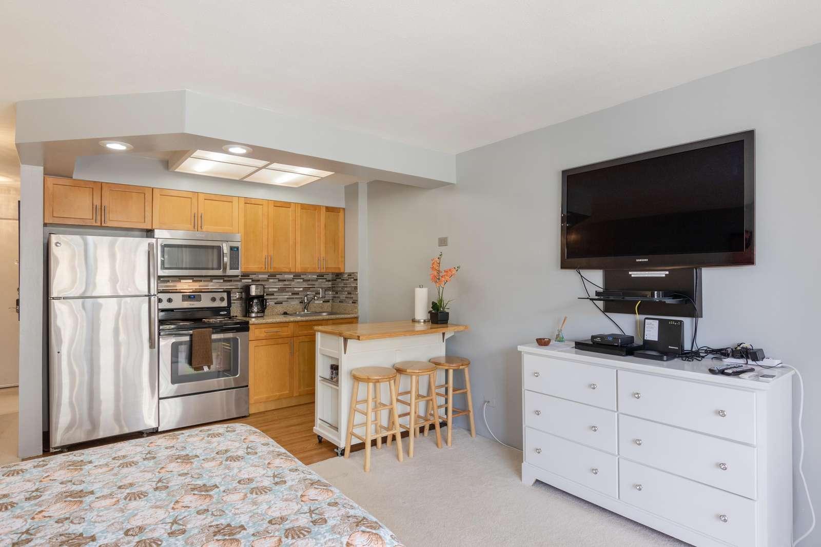 View of Kitchen & TV/DVD Player/Dresser