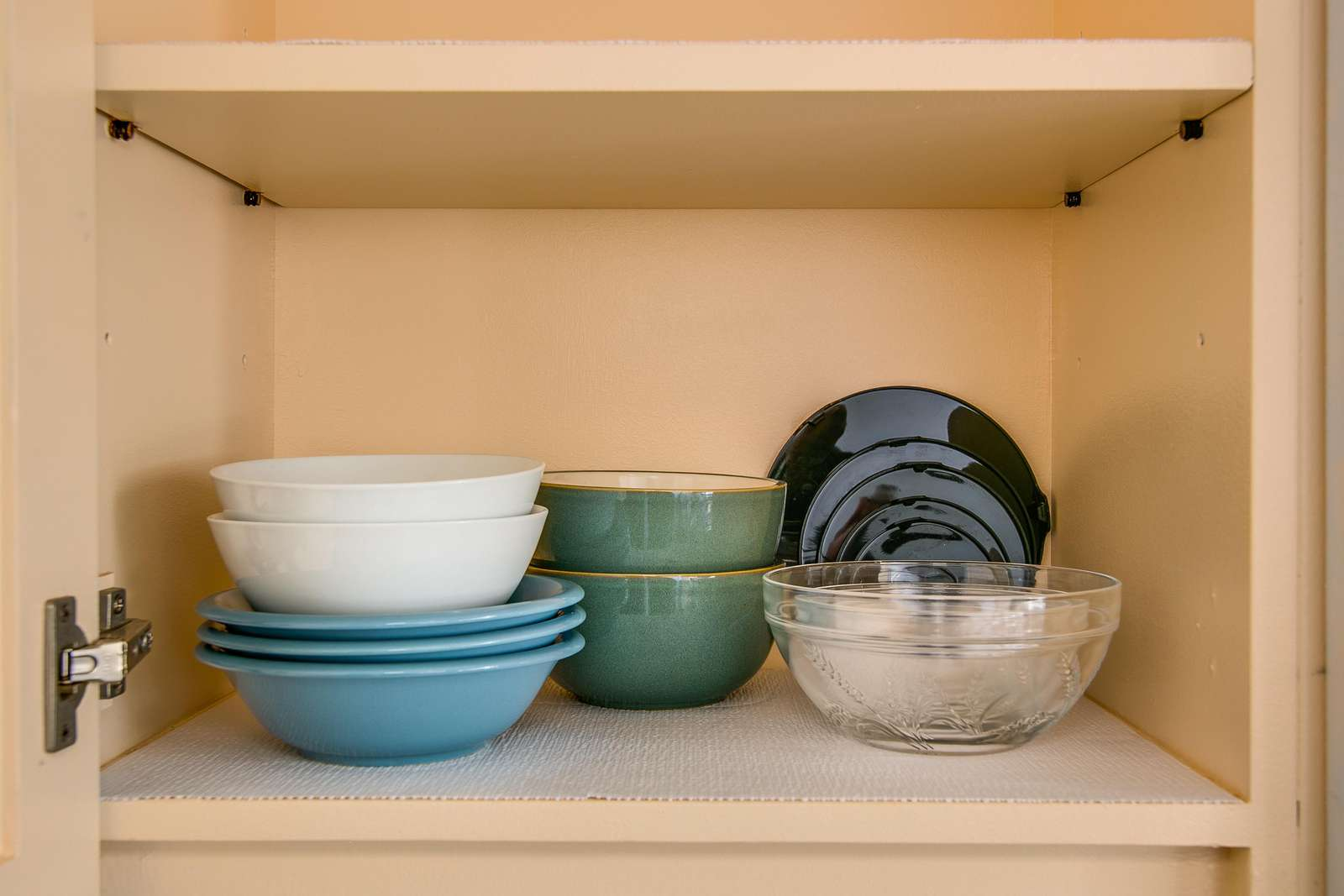 Plenty of dishes in the various cupboards