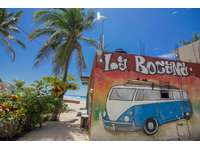 Take a surf lesson at the nearby surf shop thumb