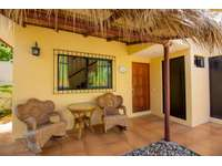 Casita Exterior with rocking chairs thumb