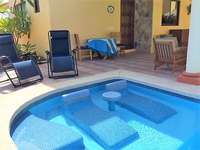 In-pool loungers & plenty of seating on the patio thumb
