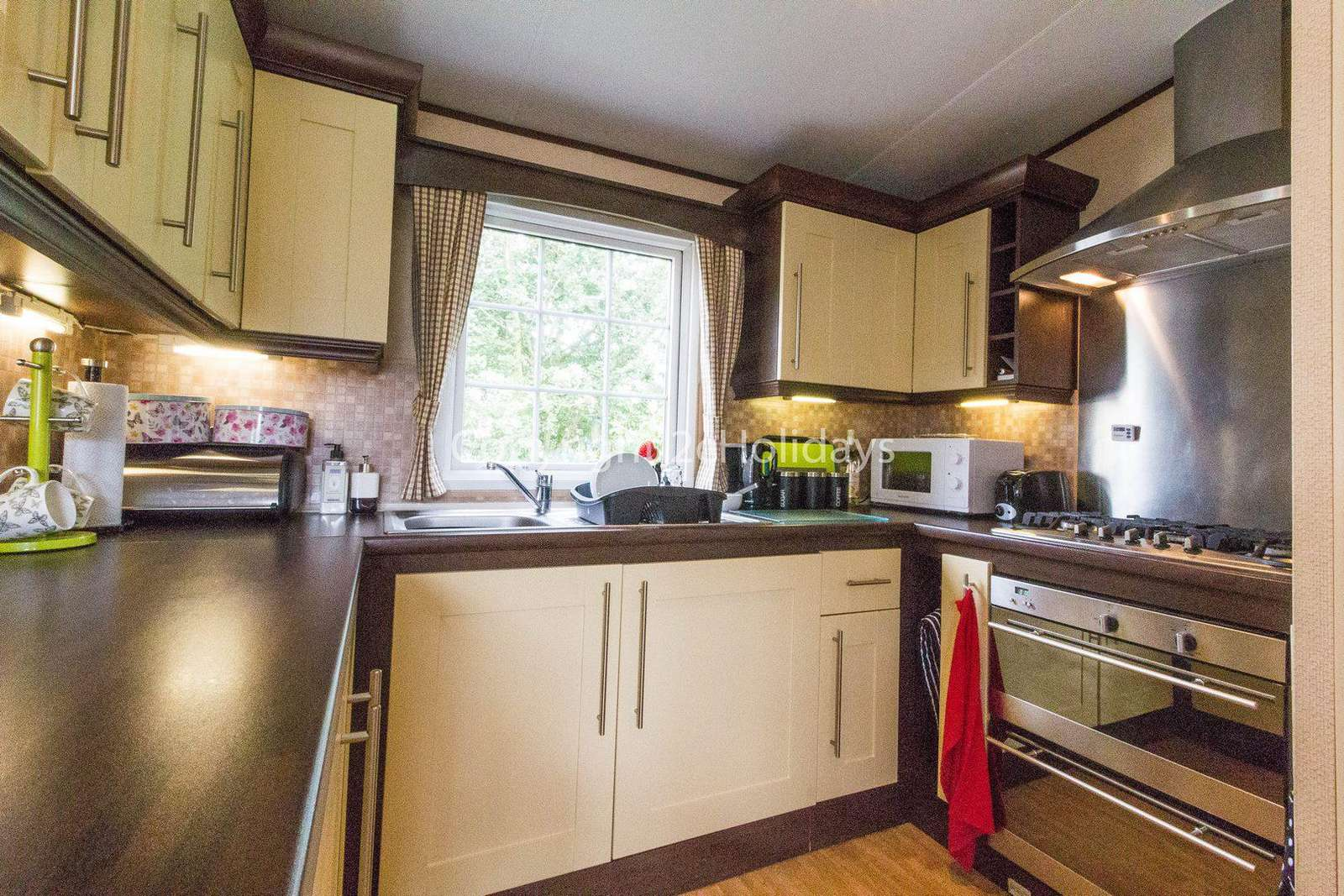 Great kitchen area in this caravan for hire.