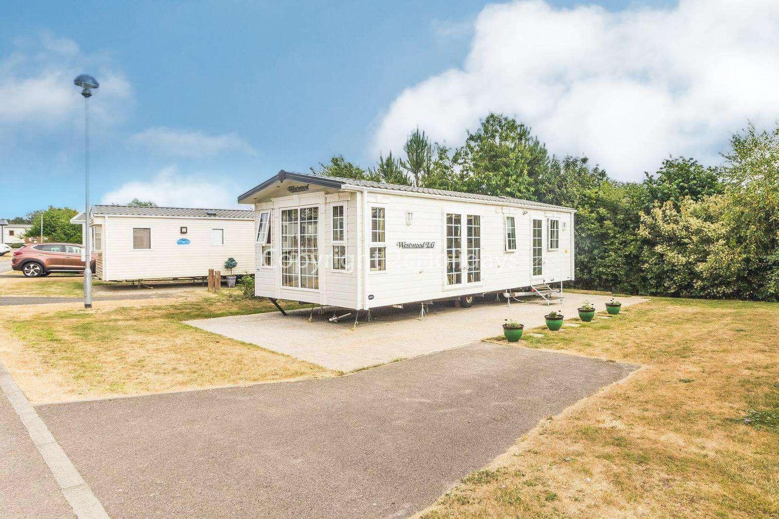 10017CW – Castle Walk area (Bure Village) 2 bed, 5 berth caravan. Ruby rated - property