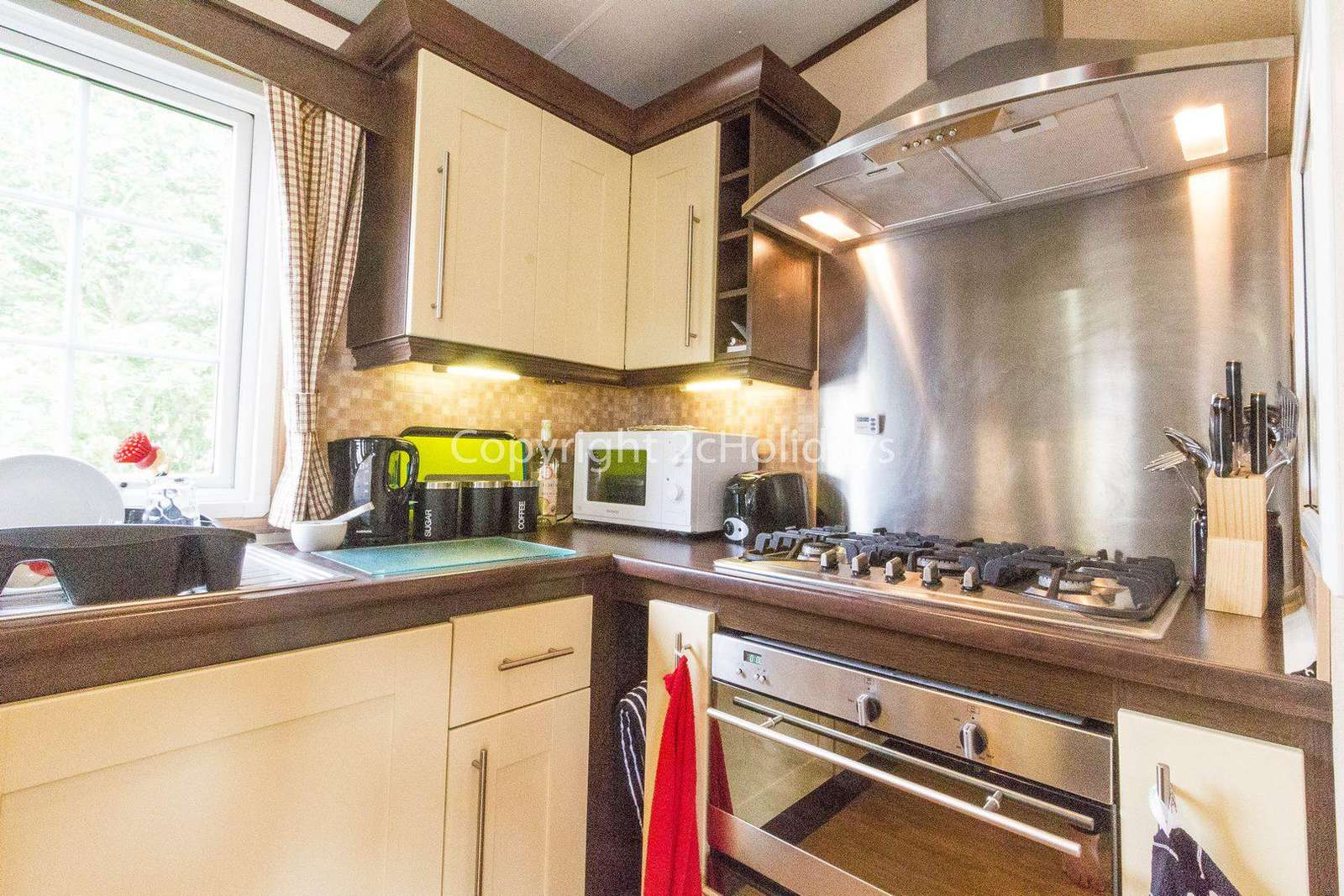 Fully equipped kitchen in this caravan for hire.