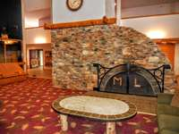 Enjoy free Wi-Fi by the large fireplace in Mountain Lodge's main lobby thumb