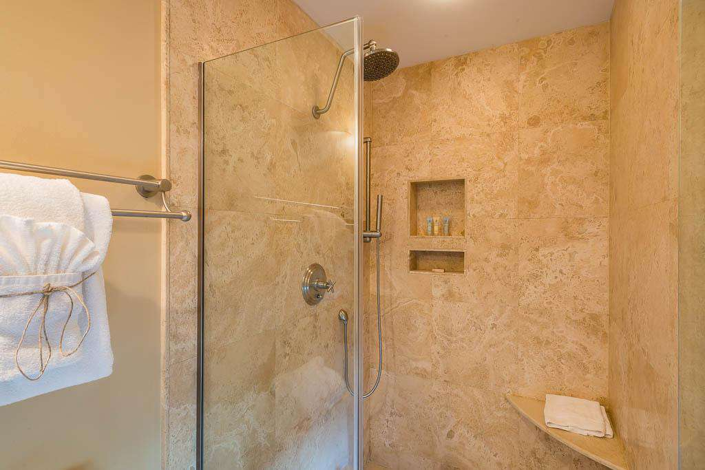 Master bathroom with glass enclosed shower.