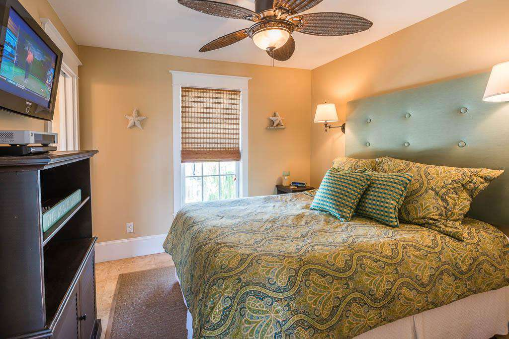 Master Bedroom with king bed, private bath and flat screen TV.