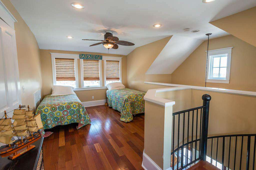 Upstairs loft with 2 twin beds and trundle with private bath.