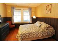 1st floor bedroom. Fullsize bed. Flatscreen cable TV, 2 dressers, near 1st floor half bathroom. thumb