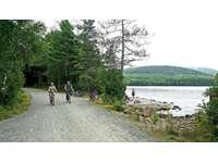 Enjoy bicycling in Acadia National Park. This is Eagle Lake, a short drive away. You can also ride bikes from our home down Ledgelawn into Acadia. thumb