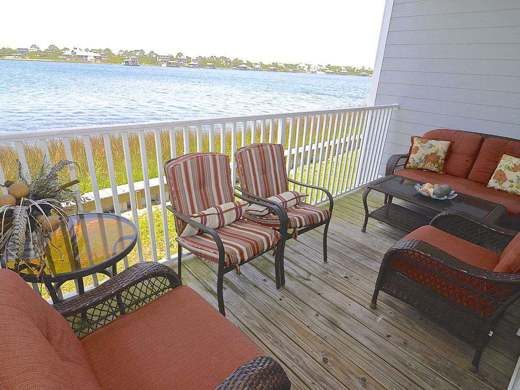 Waterfront Balcony with Comfortable Seating - property