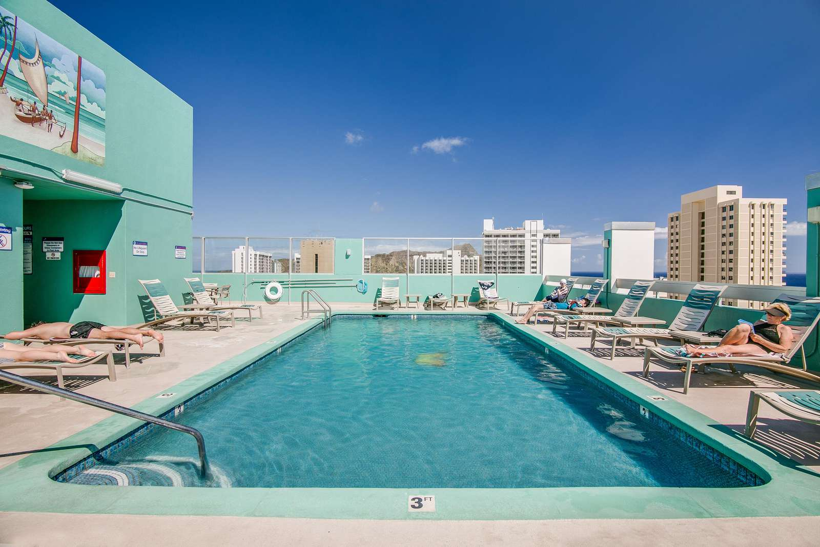 Large rooftop pool with ample sun loungers