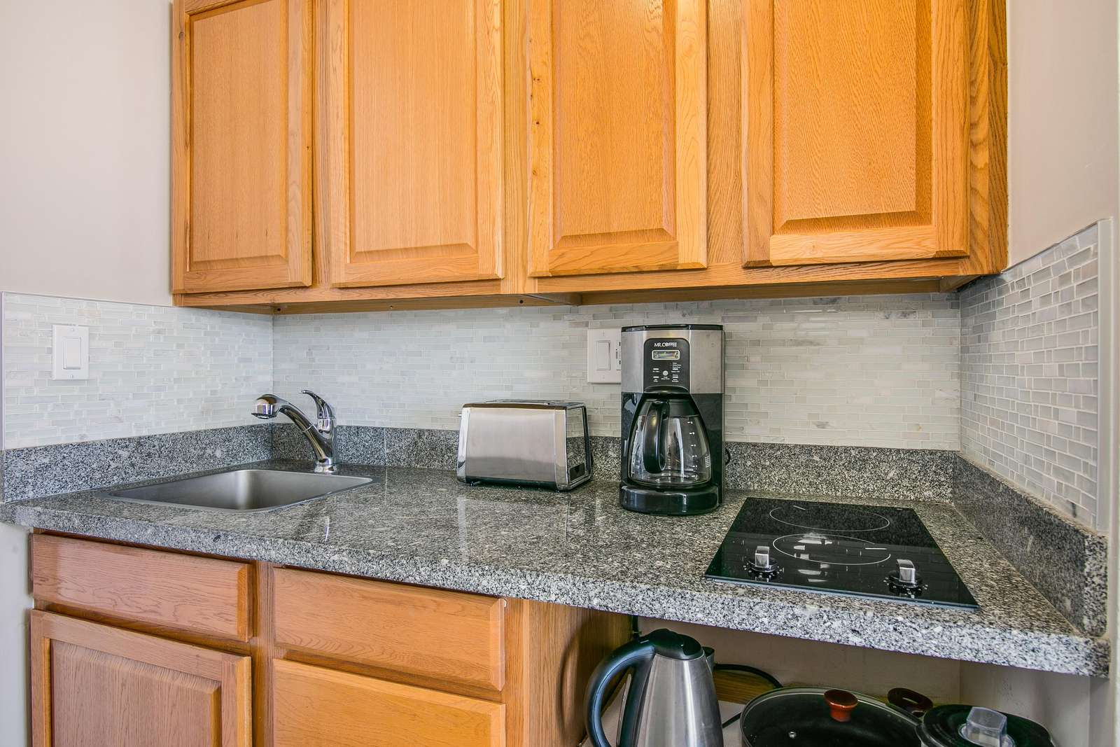 Stove top, Coffee maker, Toaster and pots a& pans included