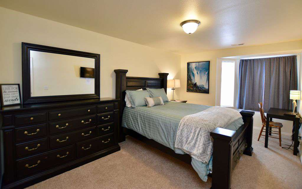 Master bedroom with plush queen bed and walk-in closet!