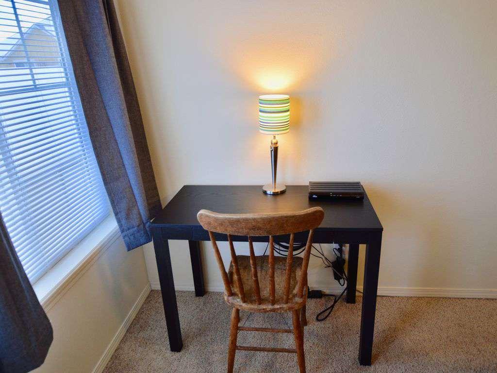 Desk for using laptop.
