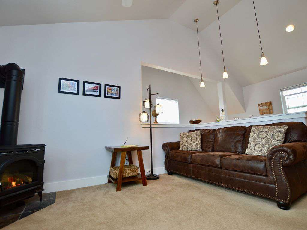 Living room area with gas fireplace.
