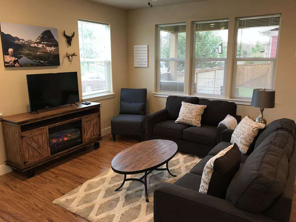 Cozy, modern, and rustic living room with electric fireplace & flat screen t.v.!