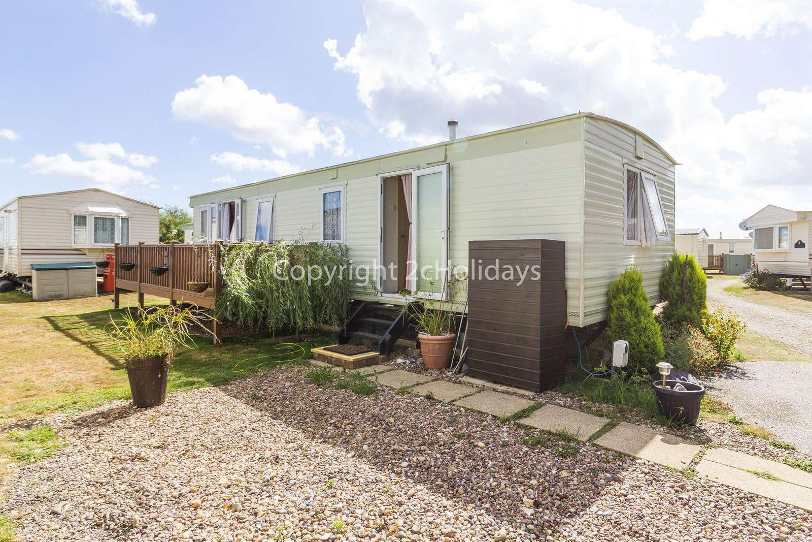 6 berth pet friendly accommodation with decking at Azure Seas Holiday Village