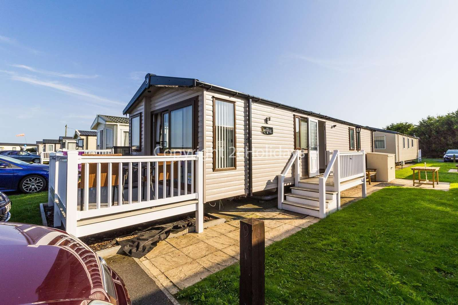 8 berth accommodation with decking at Caister Haven Holiday Park - property