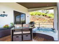 Oversized covered terrace with Jacuzzi, outdoor dining area and loungers thumb