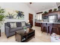Spacious living area, kitchen, breakfast bar, Smart TV thumb